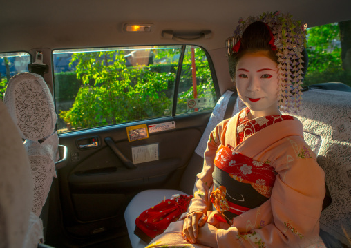 16 Years old maiko called chikasaya in a taxi, Kansai region, Kyoto, Japan