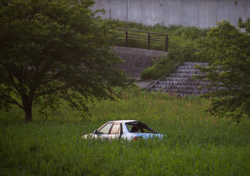 A destroyed and abandoned car by 2011 tsunami, Fukushima prefecture, Tomioka, Japan