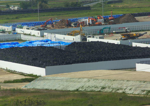 Bags containing irradiated debris are stacked in an area that was affected by the 2011 tsunami and nuclear disaster, Fukushima prefecture, Naraha, Japan