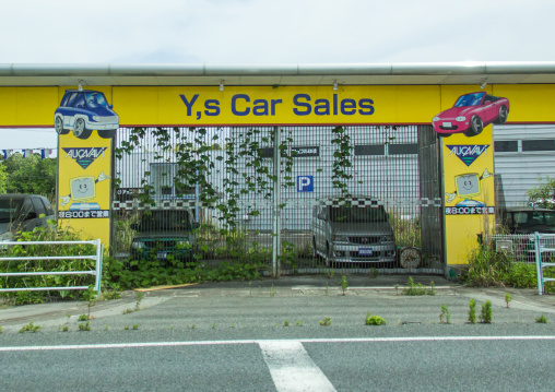 Abandoned car shop in the difficult-to-return zone after the daiichi nuclear power plant irradiation, Fukushima prefecture, Tomioka, Japan