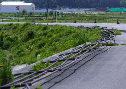 A collapsed fence road by the 2011 earthquake and tsunami, Fukushima prefecture, Futaba, Japan