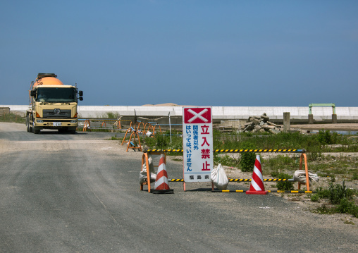 No entry sign in front of a truck in the highly contaminated area after the tsunami and the daiichi nuclear power plant irradiation, Fukushima prefecture, Namie, Japan