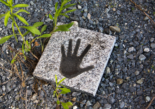 Handprint in the garden of house in the highly contaminated zone after the daiichi nuclear power plant explosion, Fukushima prefecture, Iitate, Japan
