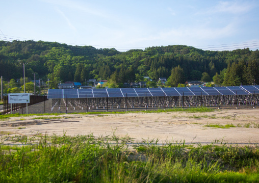 Solar panels in the highly contaminated area after the daiichi nuclear power plant irradiation, Fukushima prefecture, Iitate, Japan