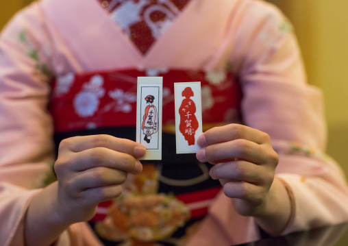 16 Years old maiko called chikasaya showing her business cards, Kansai region, Kyoto, Japan