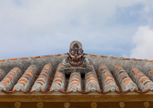 Shisa lion atop traditional tile roof to protect the house from the bad spirits, Yaeyama Islands, Taketomi island, Japan
