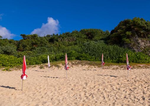 Beach umbrella in sunset beach, Yaeyama Islands, Ishigaki, Japan