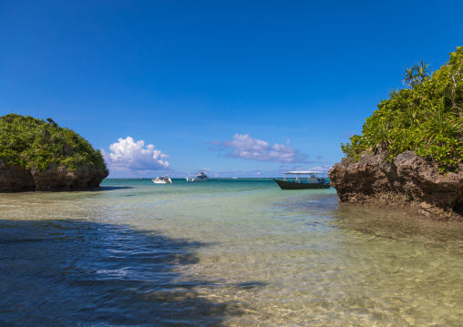 Tropical lagoon with clear blue water surrounded by lush greenery in Kabira bay, Yaeyama Islands, Ishigaki, Japan