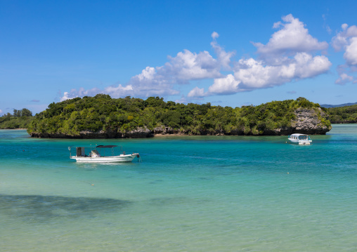 Glass bottom boats in the tropical lagoon beach with clear blue water in Kabira bay, Yaeyama Islands, Ishigaki, Japan