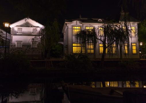 Old houses along the riverbank by night in Bikan historical quarter, Okayama Prefecture, Kurashiki, Japan
