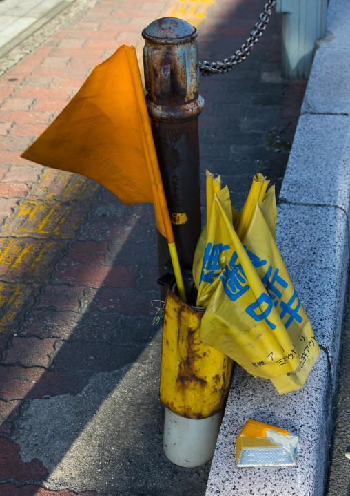 Flags in the street used by the children to cross the roads, Okayama Prefecture, Kurashiki, Japan