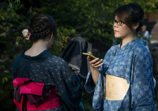 Japanese women in traditional clothing in Bikan historical quarter, Okayama Prefecture, Kurashiki, Japan