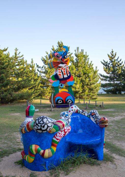 Karel appel and niki de saint phalle sculptures in Benesse house  hotel garden, Seto Inland Sea, Naoshima, Japan