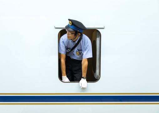 Shinkansen train controller looking thru a window, Hypgo Prefecture, Himeji, Japan