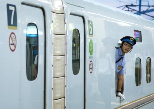 Security guard on Shinkansen bullet train platform, Hypgo Prefecture, Himeji, Japan