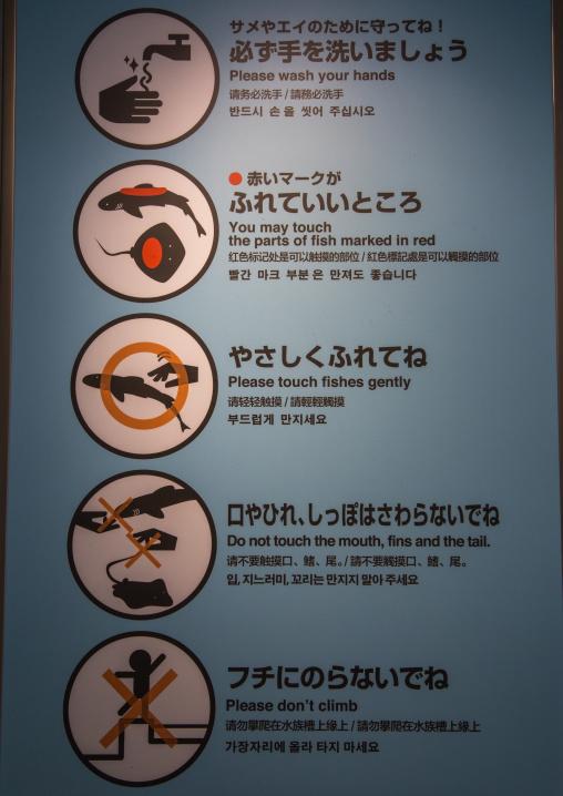 Warning signs in the touch pool in Kaiyukan aquarium, Kansai region, Osaka, Japan