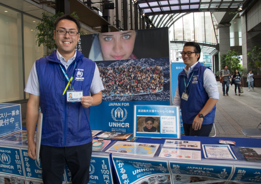 Unhcr charity volunteers on street collecting money for refugees, Kanto region, Tokyo, Japan