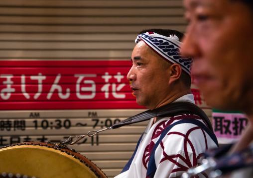 Japanese drummers during the Koenji Awaodori dance summer street festival, Kanto region, Tokyo, Japan