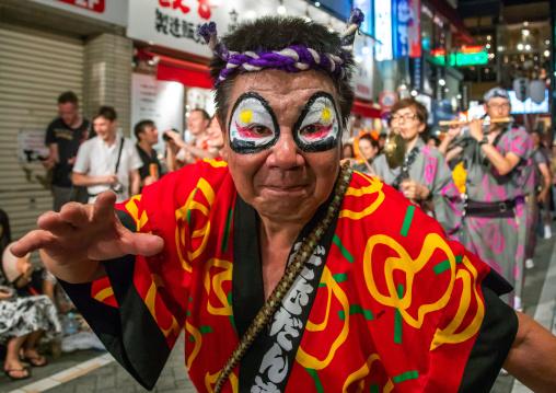 Japanese dancer with makeup during the Koenji Awaodori dance summer street festival, Kanto region, Tokyo, Japan