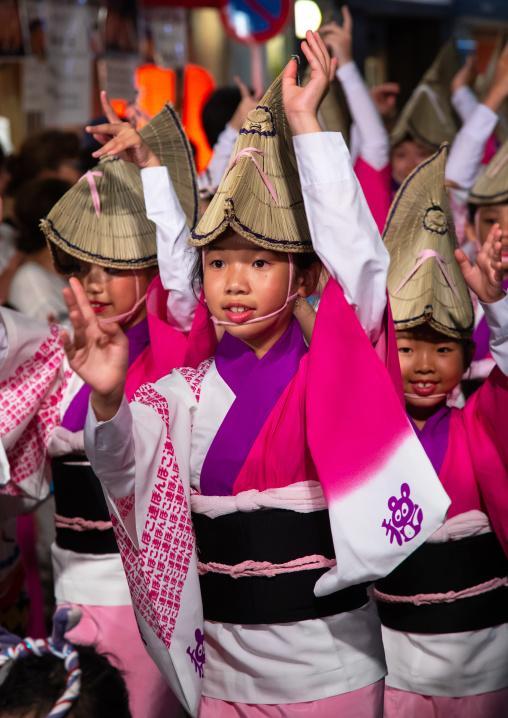 Japanese children with straw hats during the Koenji Awaodori dance summer street festival, Kanto region, Tokyo, Japan