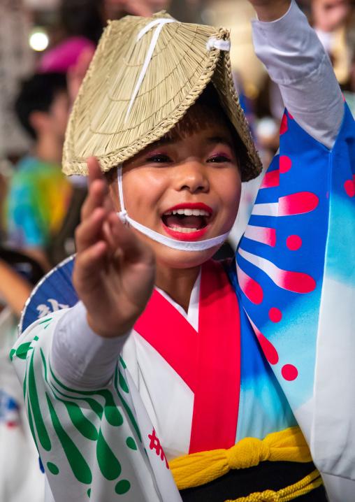 Japanese girl with straw hat during the Koenji Awaodori dance summer street festival, Kanto region, Tokyo, Japan