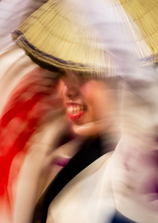 Japanese woman with straw hats during the Koenji Awaodori dance summer street festival, Kanto region, Tokyo, Japan