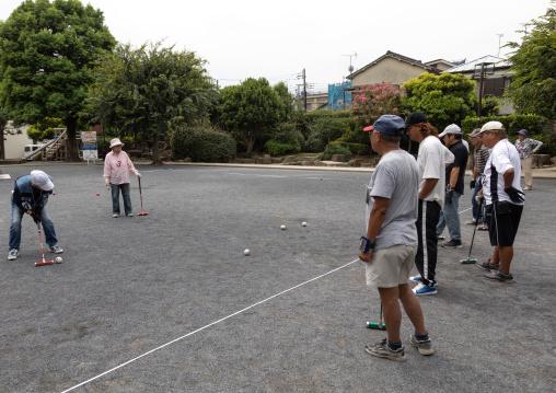 Senior japanese people playing gateball, Kanto region, Tokyo, Japan