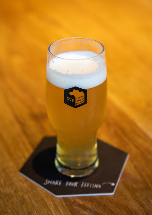 Close-up of spring valley brewery beer glass, Kanto region, Tokyo, Japan