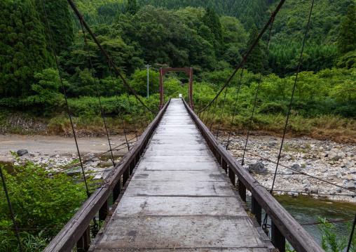 Wooden bridge in forest, Kyoto Prefecture, Miyama, Japan
