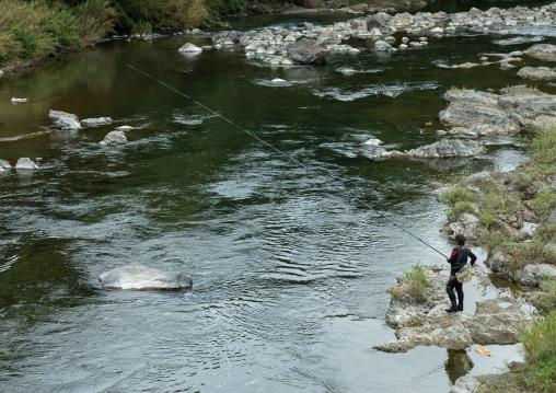 Japanese man fishing in a river, Kyoto Prefecture, Miyama, Japan