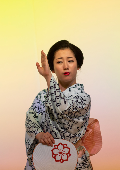 Maiko woman dancing on stage during a stage, Kansai region, Kyoto, Japan