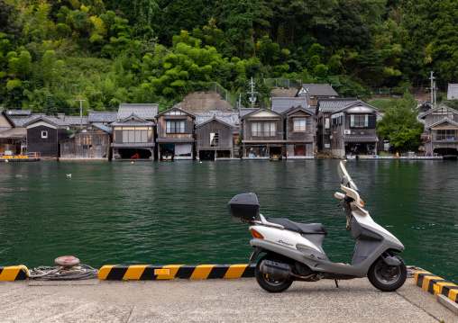 Scotter parked in front of funaya fishermen houses, Kyoto prefecture, Ine, Japan