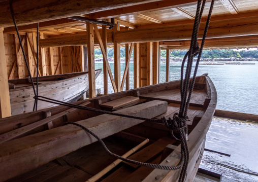 Traditional wooden boats parked inside a funaya house, Kyoto prefecture, Ine, Japan