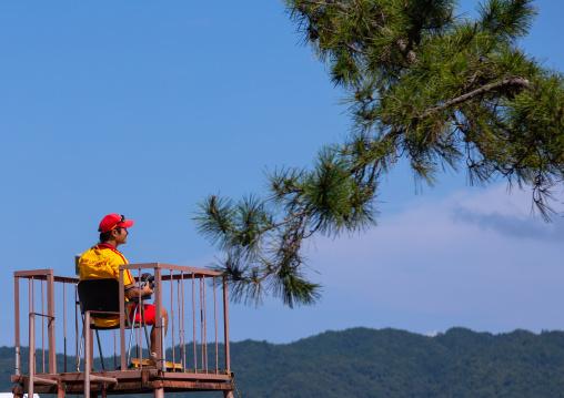 Japanese lifeguard on a high chair in Amanohashidate beach, Kyoto Prefecture, Miyazu, Japan