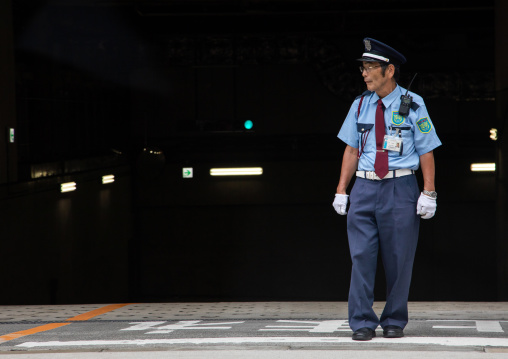 Senior japanese security guard in the street, Kansai region, Osaka, Japan