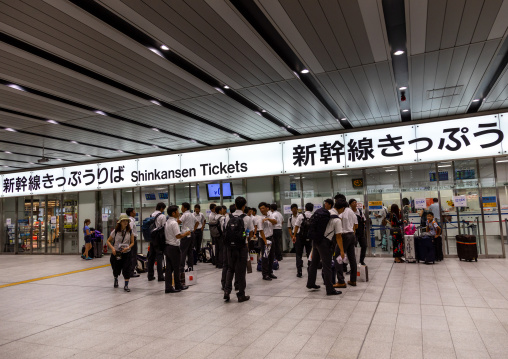 Students in Shinkansen train station, Kansai region, Osaka, Japan