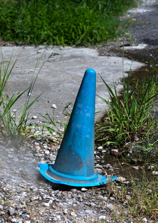 Traffic cone to protect a hot spring in the street, Oita Prefecture, Beppu, Japan