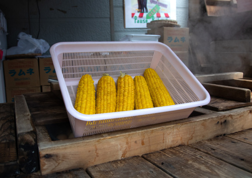 Corns for sale to cook in the hot steam of Kamado jigoku cooking pot hell, Oita Prefecture, Beppu, Japan