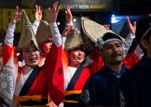 Japanese women with straw hats during the Koenji Awaodori dance summer street festival, Kanto region, Tokyo, Japan
