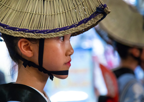 Japanese child with straw hat during the Koenji Awaodori dance summer street festival, Kanto region, Tokyo, Japan