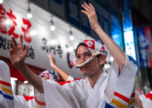 Japanese dancers during the Koenji Awaodori dance summer street festival, Kanto region, Tokyo, Japan