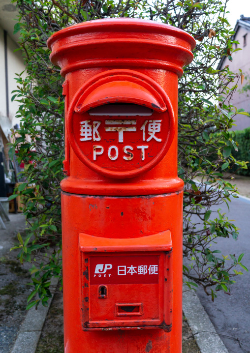 Japan post red mailbox in the street, Ishikawa Prefecture, Kanazawa, Japan