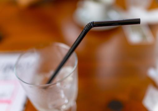 Plastic straw in a drinking glass, Ishikawa Prefecture, Kanazawa, Japan