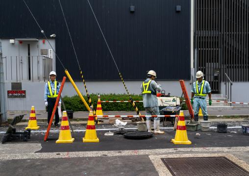 Japanese workers repairing the road, Ishikawa Prefecture, Kanazawa, Japan