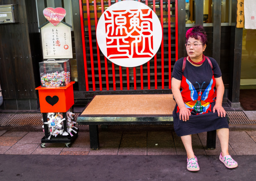 Japanese woman suffering from the heat in omicho market, Ishikawa Prefecture, Kanazawa, Japan
