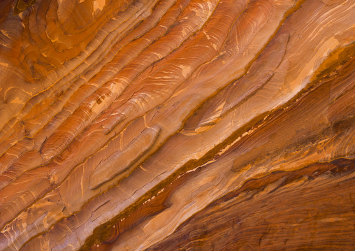 Waves Of Natural Color Drift Through A Sandstone Rock Face In Petra, Jordan
