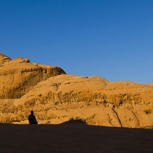 Man Praying In Wadi Rum Desert, Jordan