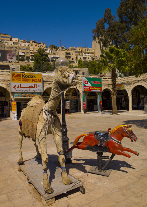Kids Playfround With Camel In Amman, Jordan
