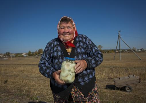Old Woman Selling Mushrooms In Burabay, Kazakhstan