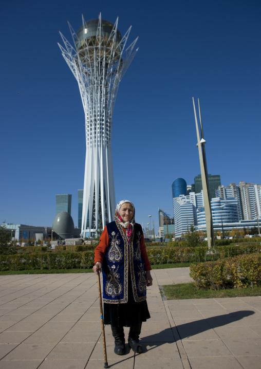 Old Woman In Front Of Baiterek Tower, Astana, Kazakhstan